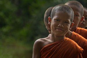 Lo Lei Monastery – novice monks walking through paddy fields, facing