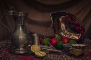 Still life in the style of Dutch masters with tuna, nectarines, and limes