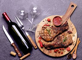 Pork steak with red wine sauce spices with vegetables
