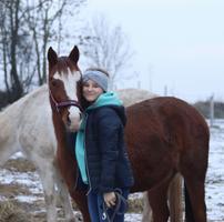 Girl side-hugging her horse