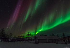 Aurora above a cabin