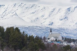 Elvebakken church with snow covered mountains