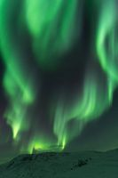 Northern lights Finnmark Norway above snow covered mountain