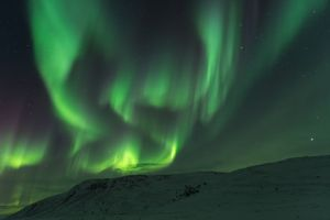 Northern lights Finnmark Norway mountains with snow