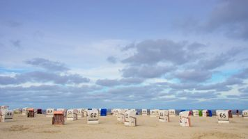 Panorama with lonely beach chairs on the North Sea