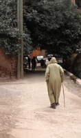 Old Moroccan man walking on streets