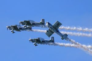 Four stunt planes in close proximity