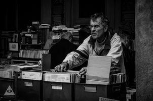 Old man in the vintage market