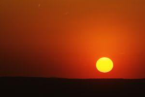 Bright yellow setting sun