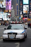 NYPD car standing at the Times Square in Manhattan, NYC