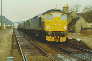 26035 with 37261 @ Rogart 26mar83 - Tony Browne