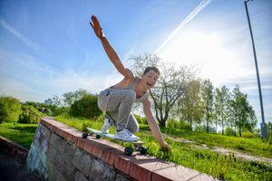 The guy skates on a skateboard