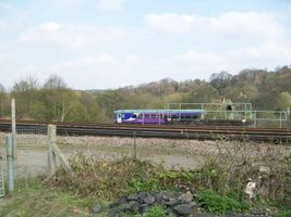 Class 153 coming out of the single line underpass at Heaton Lodge