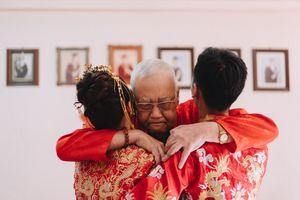 It was a long fulfilling hug. A father's wish is finally fulfilled to see his only child daughter getting married to a fine son in law and he could not ask for more.