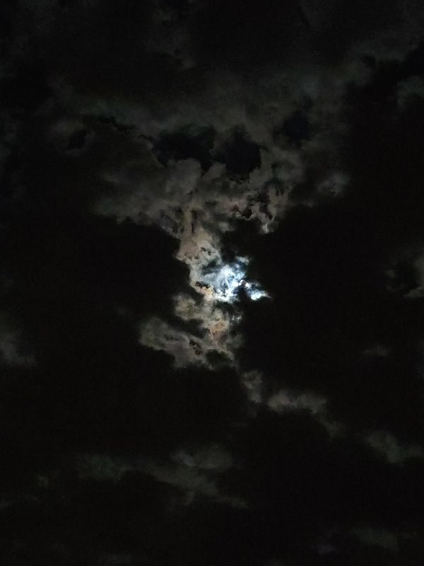 Moon dancing with the clouds