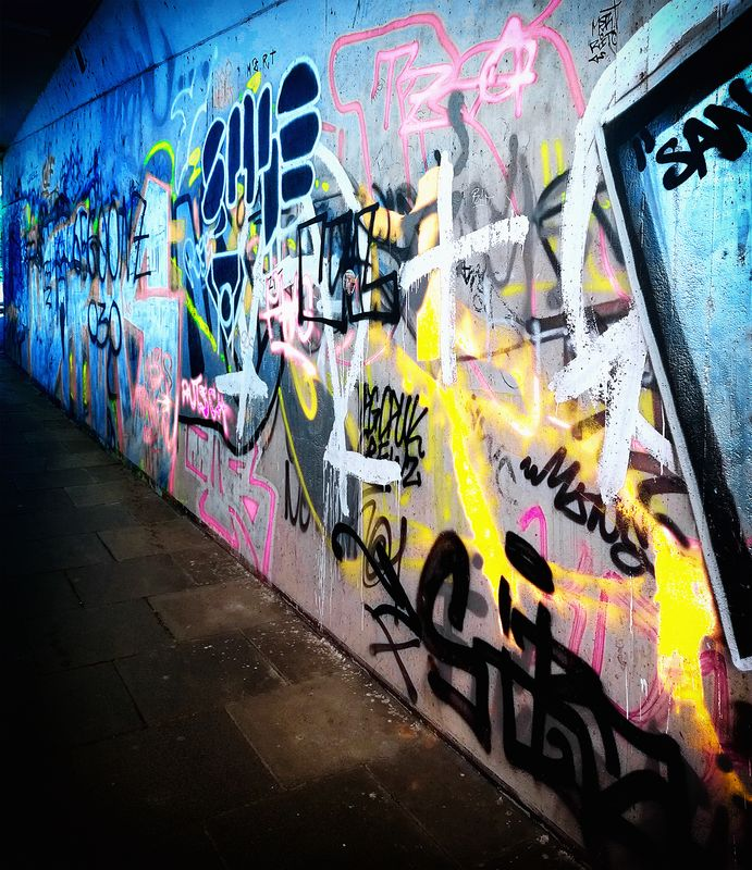 Coloured graphittis in a street subway in frankfurt am main