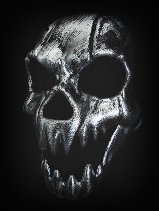 Creepy silver skull demon mask in black white