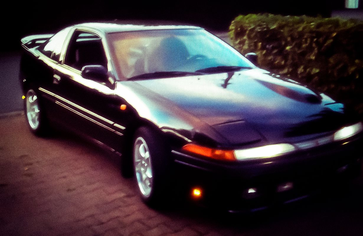 Super tuned car mitsubishi eclipse d20 top s class in black with spoiler kit and sleep eyes