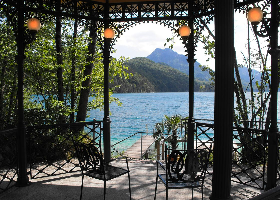 The view from the shore pavilion onto the blue lake of fuschl am see in austria