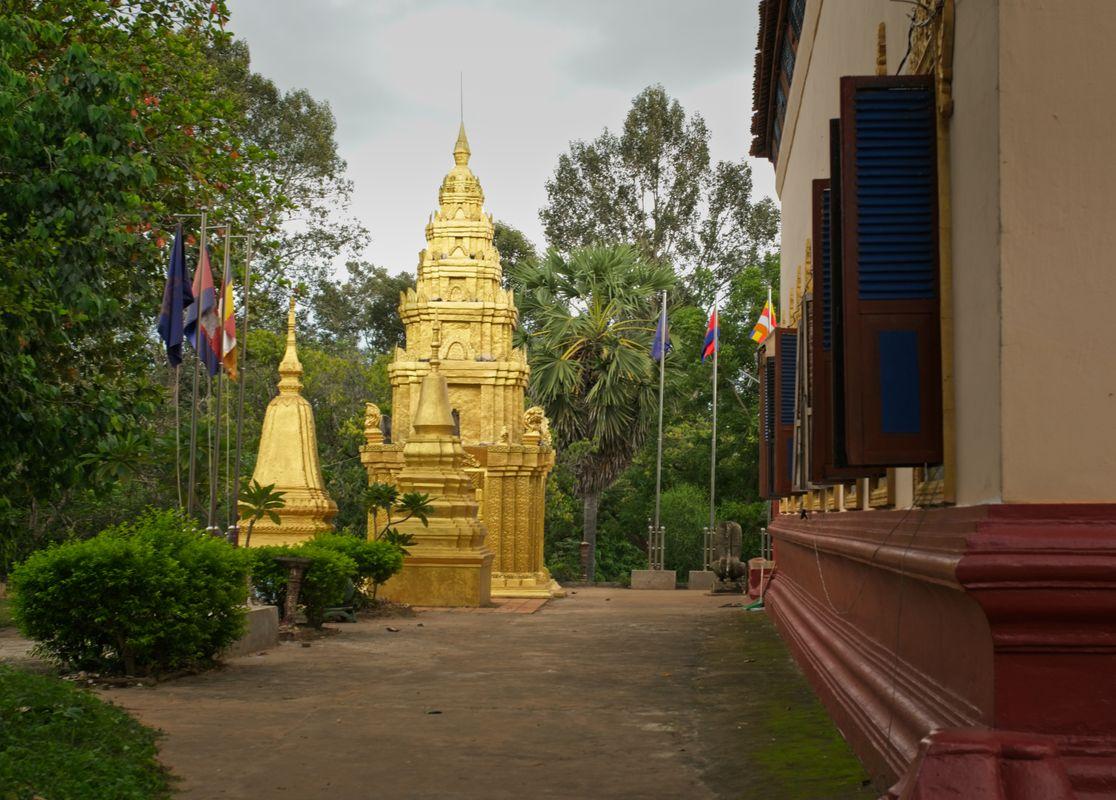 Pagoda and stupa next to monastery school