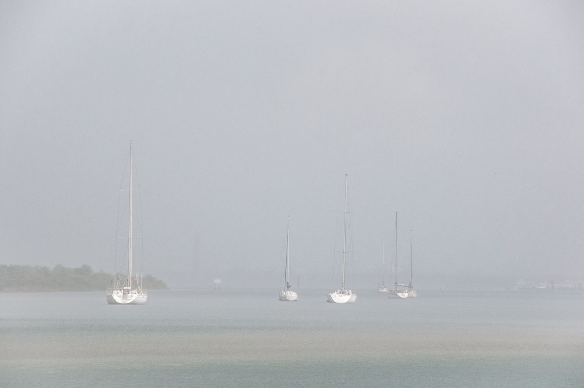 Sailing boats in the mist