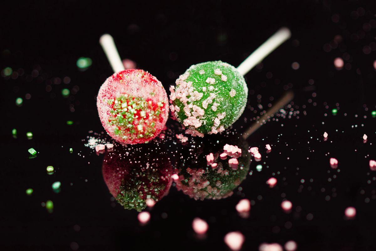 Lollypops against a black background