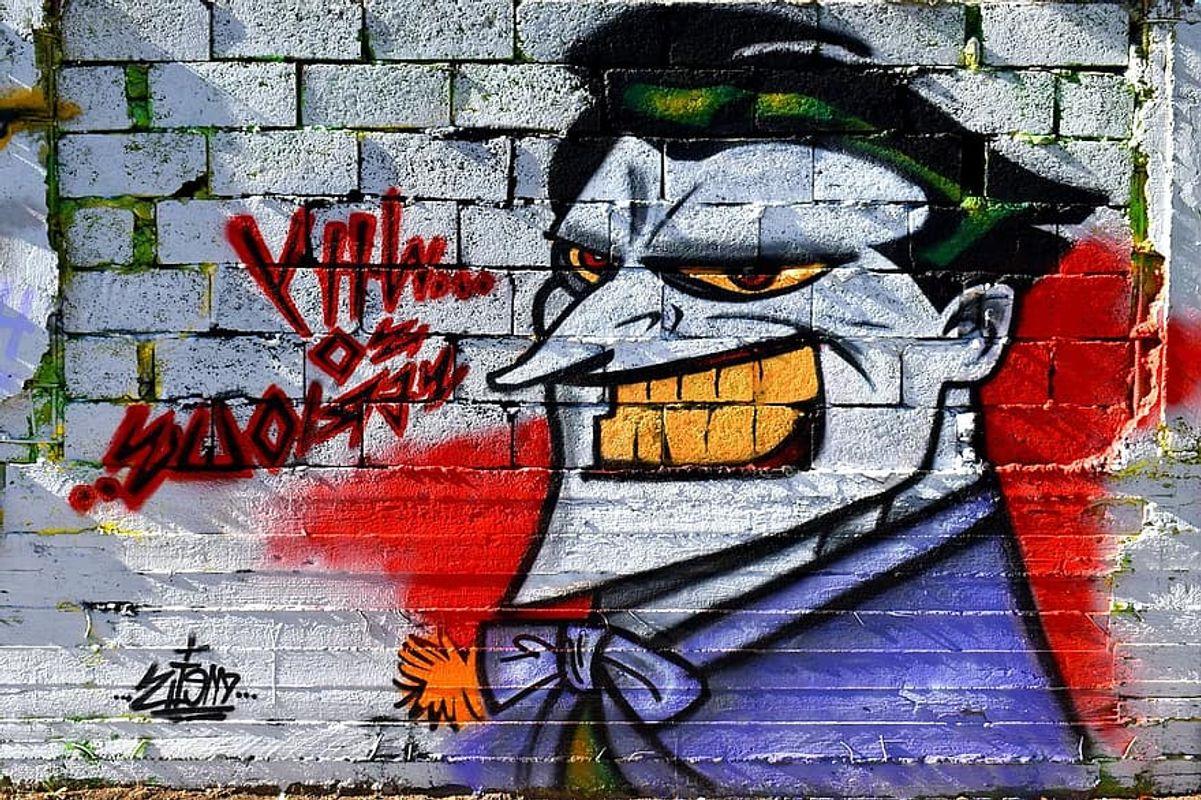 Graffiti-wall-art-painting-street-bricks-cartoon-laugh-color