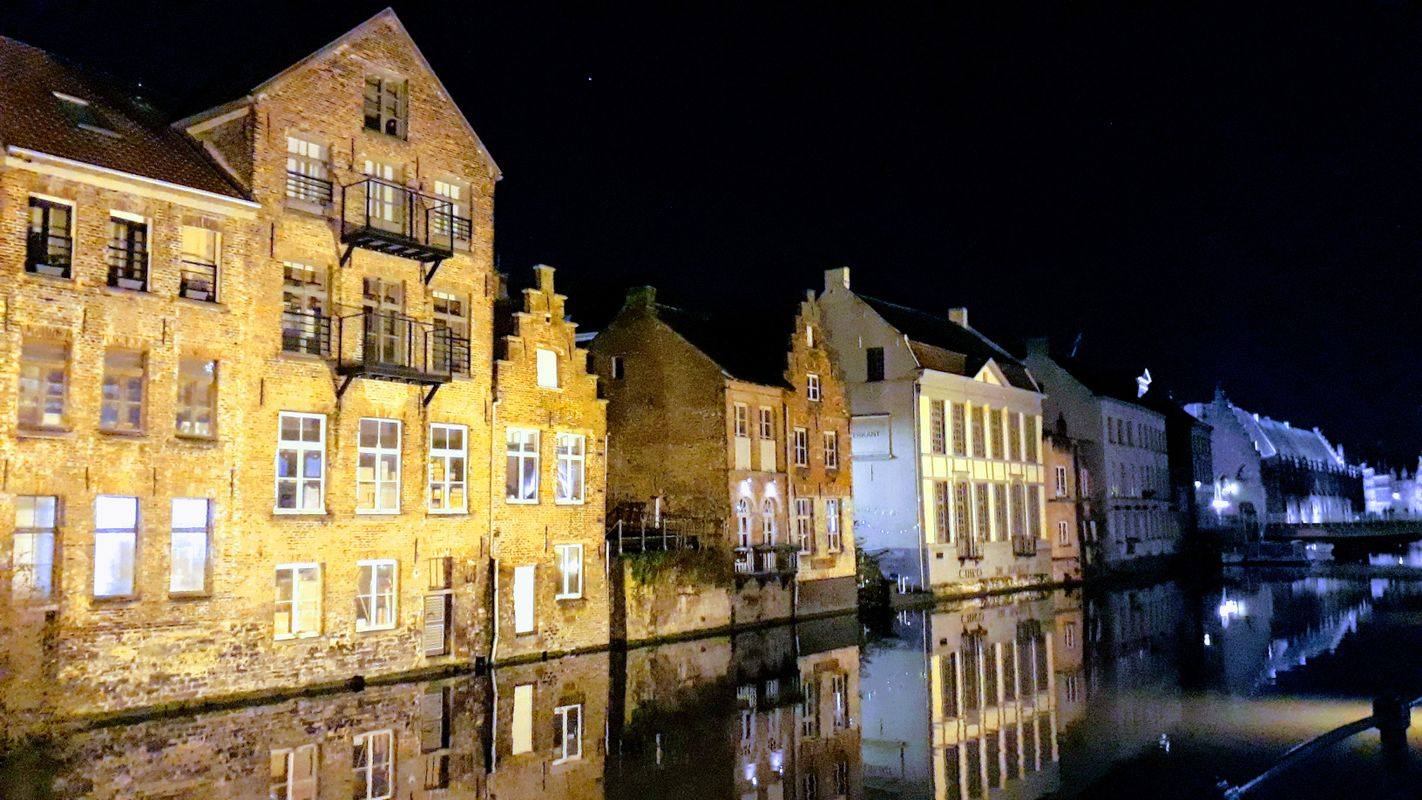 A play of light and reflections of the facades in a canal in Gent, Belgium