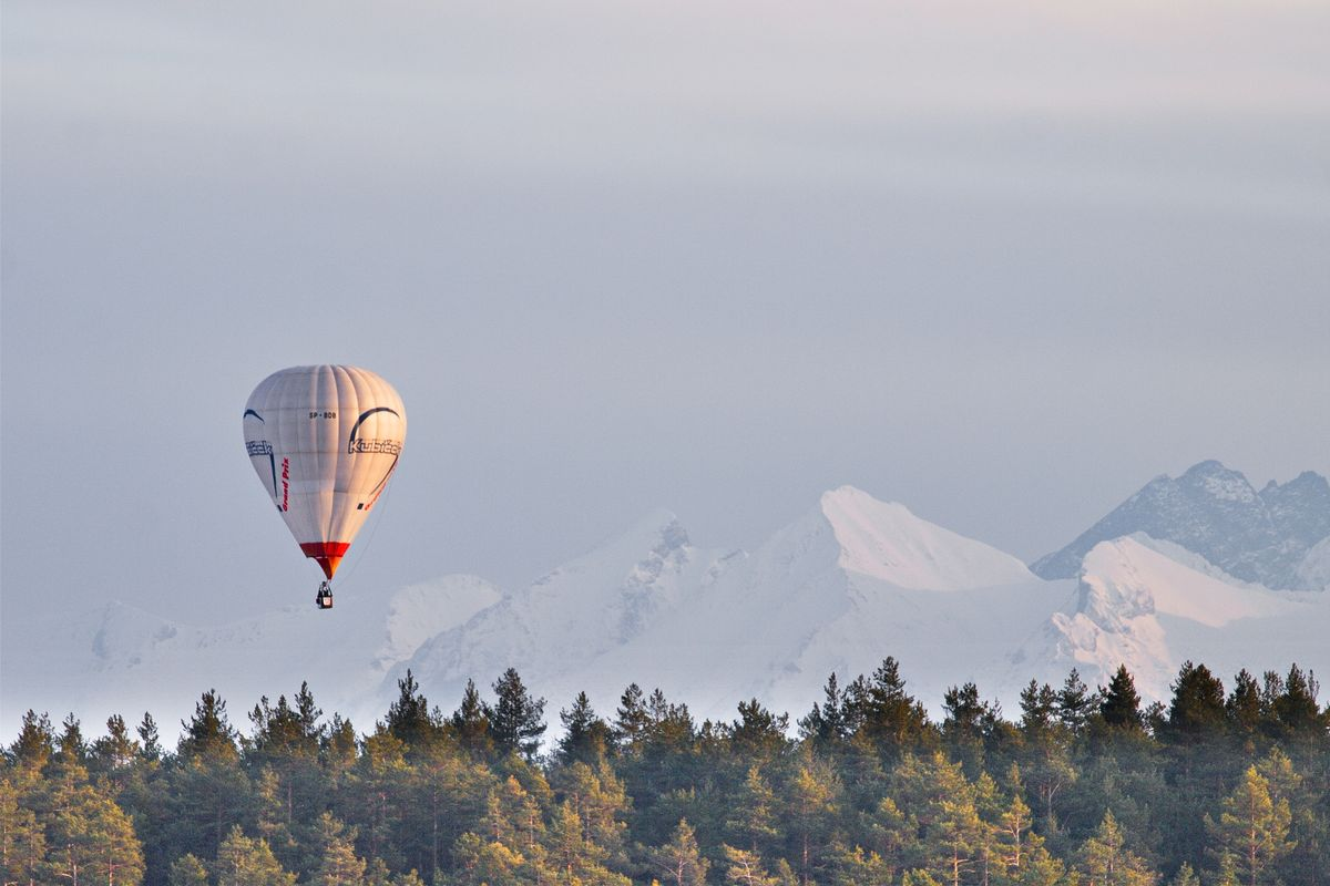 Hot-air balloon and snowy mountains