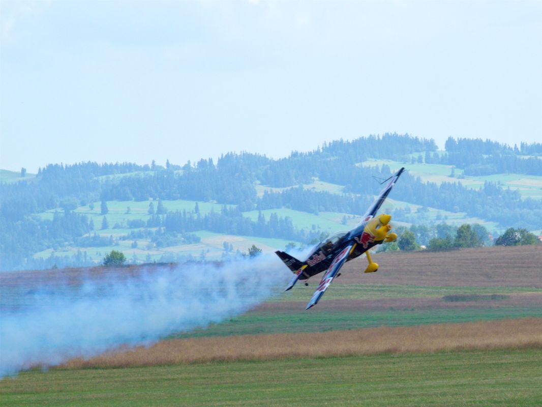 Plane flying low leaving smoke trail