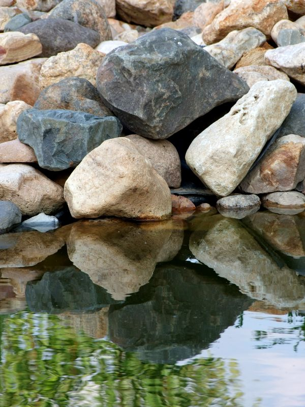Decorative stones on the bank of the small pond