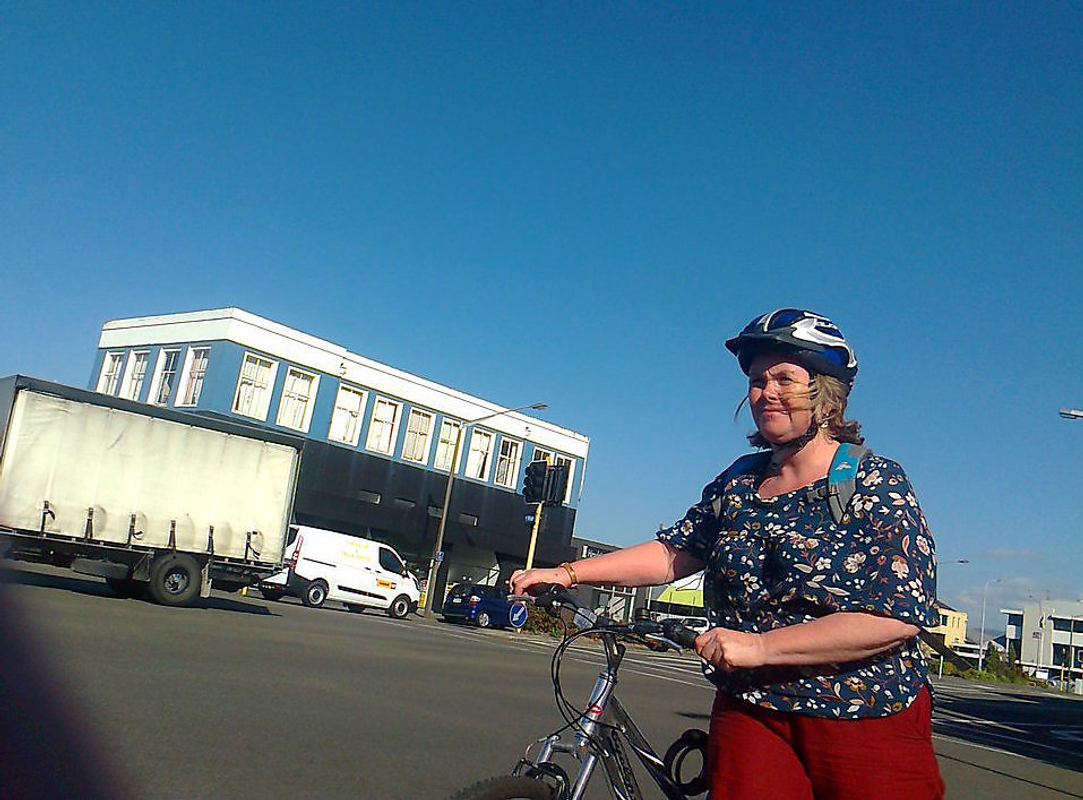 Woman with bicycle helmet