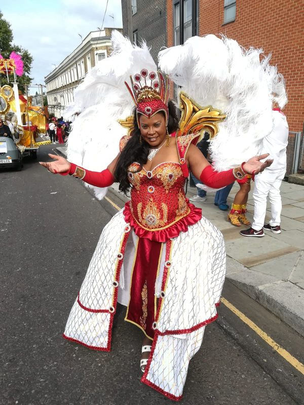 Notting Hill Carnival 2018 pre parade fun !The Queen in Costume .