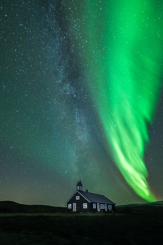 Aisaroaivi chapel with milkyway and northern lights