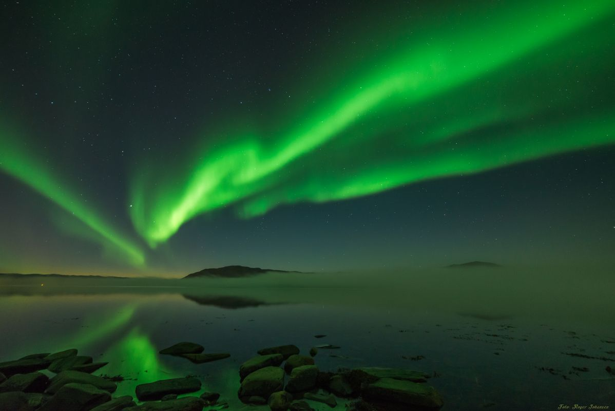 Northern Lights above Altafjord, with fog in distance