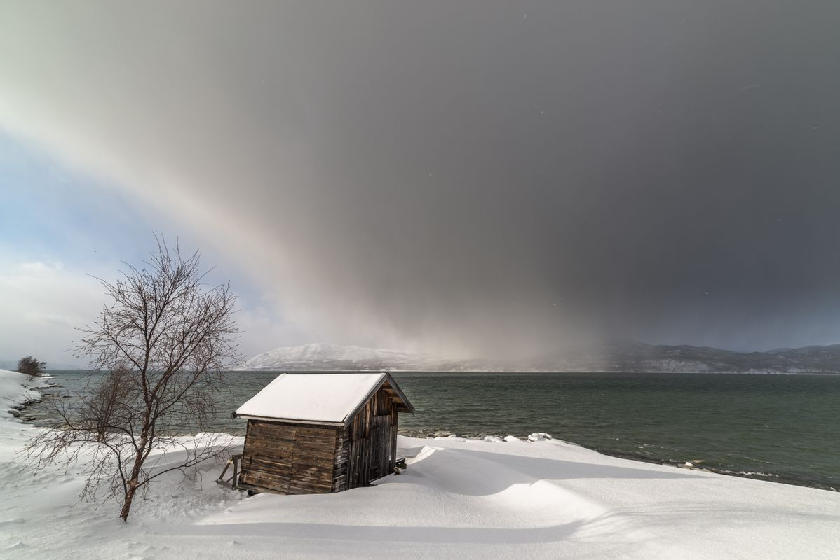 Snowy weather above Altafjord