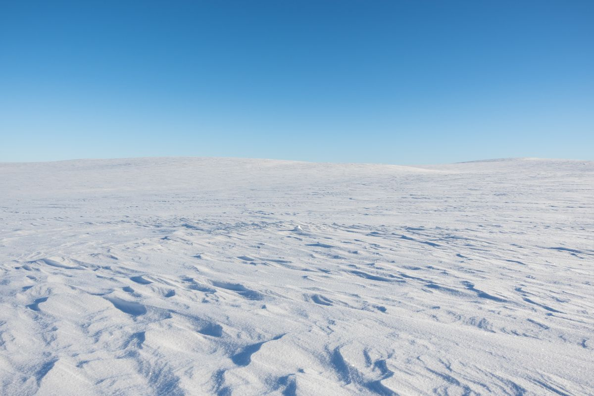 Flat snow covered arctic mountain
