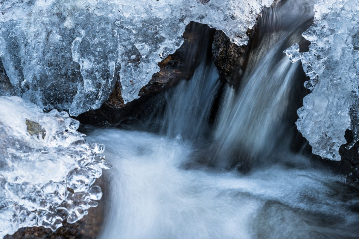 Small stream with frozen ice