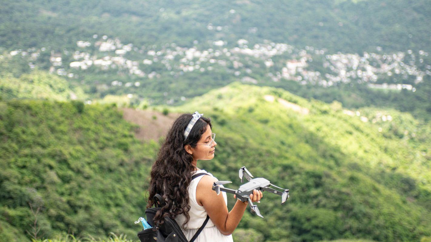 Woman drone mountain fun adventure.