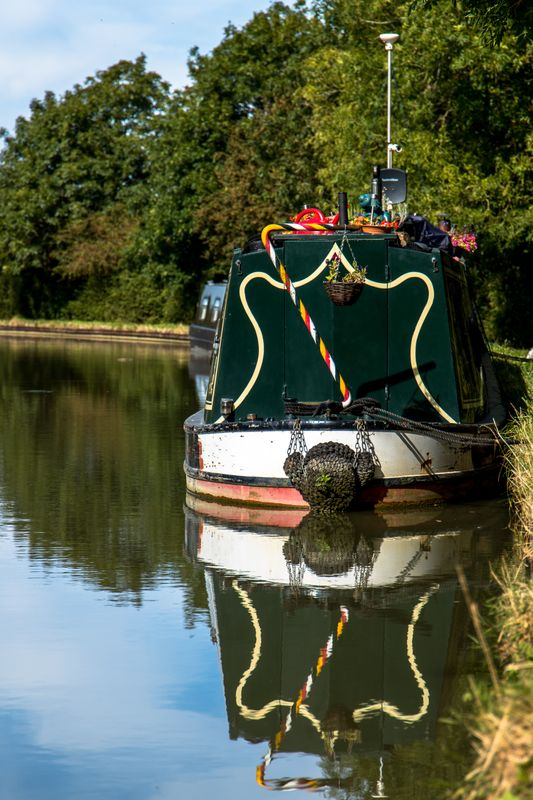 Moored canal barge by Clive Wells