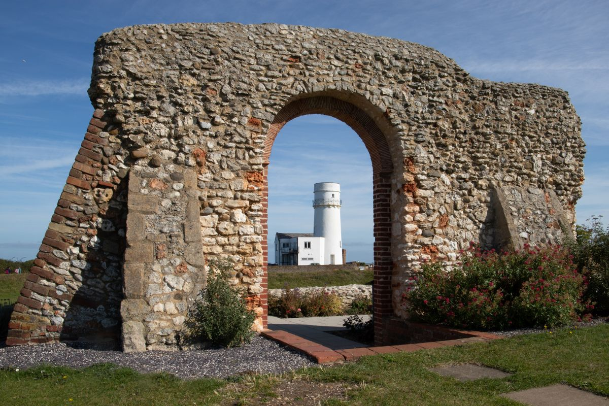 Lighthouse seen through archway by Clive Wells