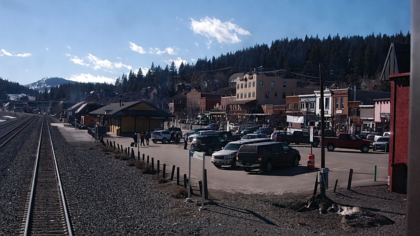 Small town, Truckee, CA USA as Amtrak's California Zephyr pulls away from station