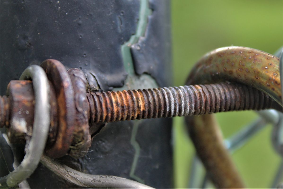 A very old metal screw.