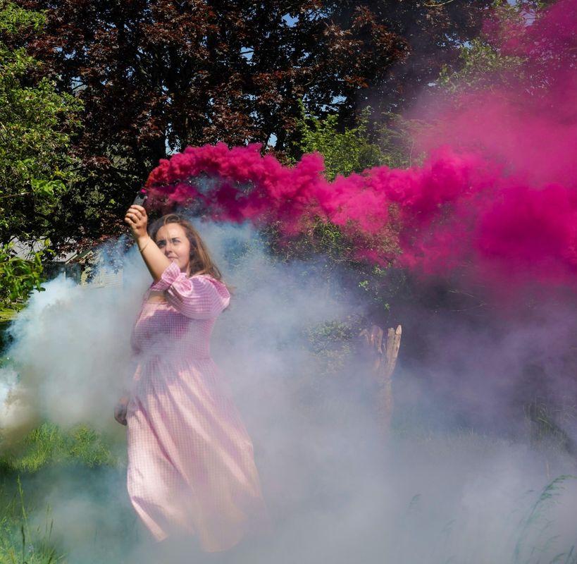 White and pink smoke bombs