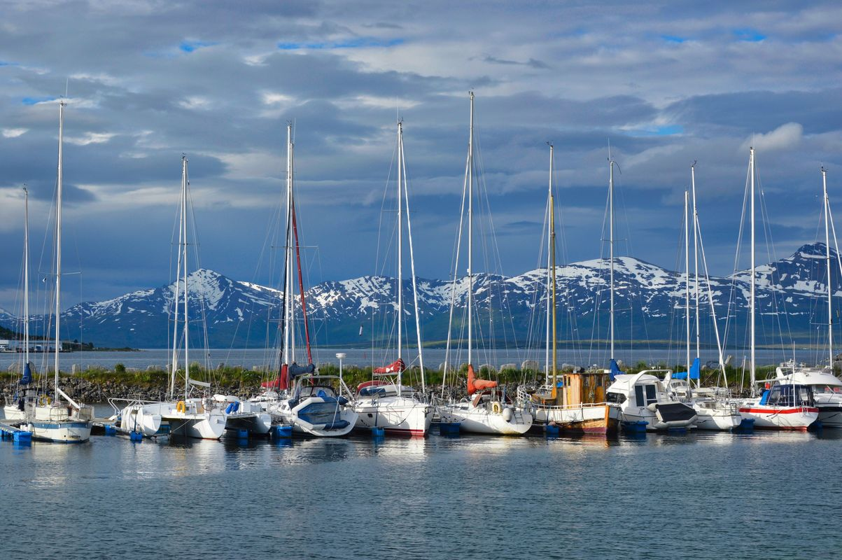 Sailing boats with snowy mountains