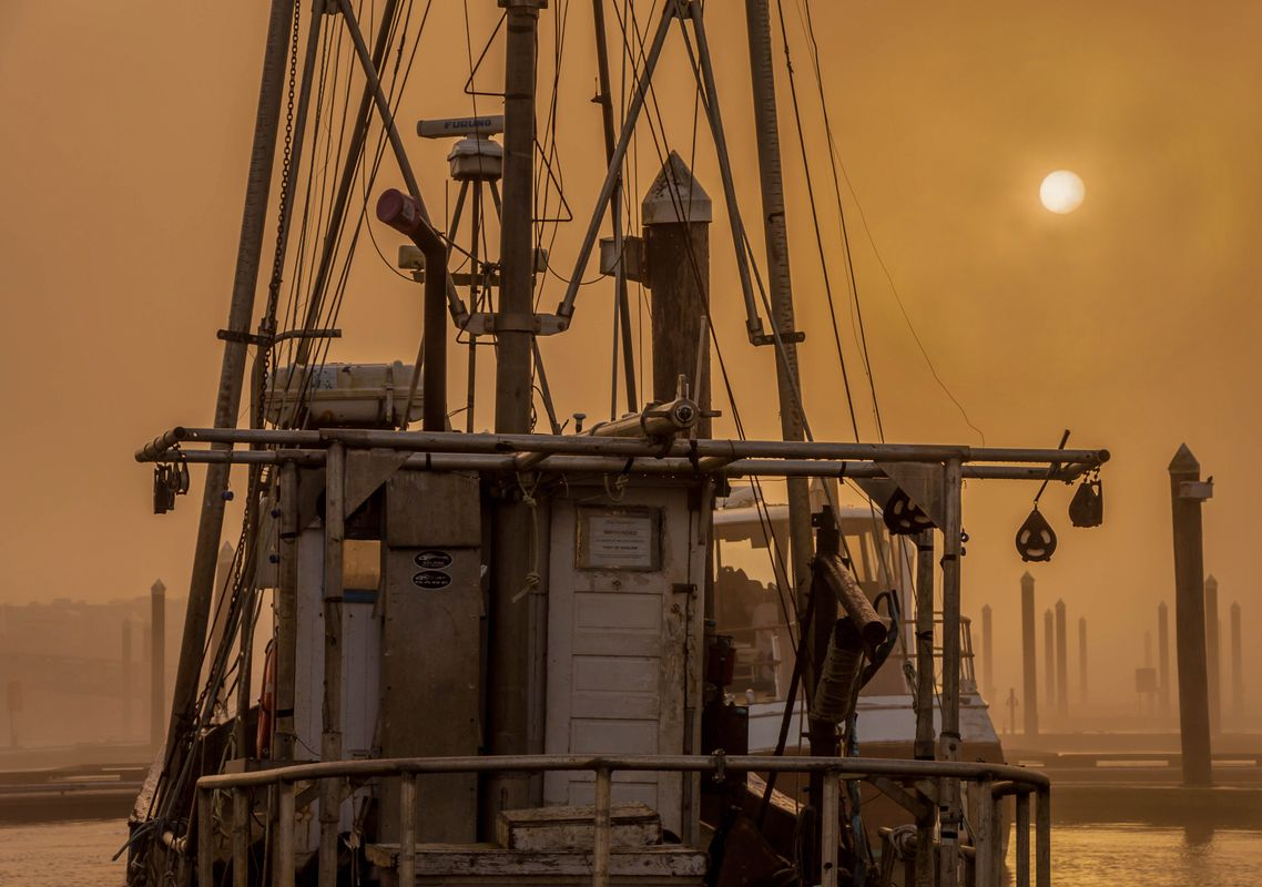Old Impounded Fishing Boat in Fog at Sunrise