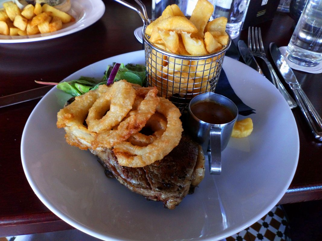 Irish Steak With Chips and Onion Rings and Gravy