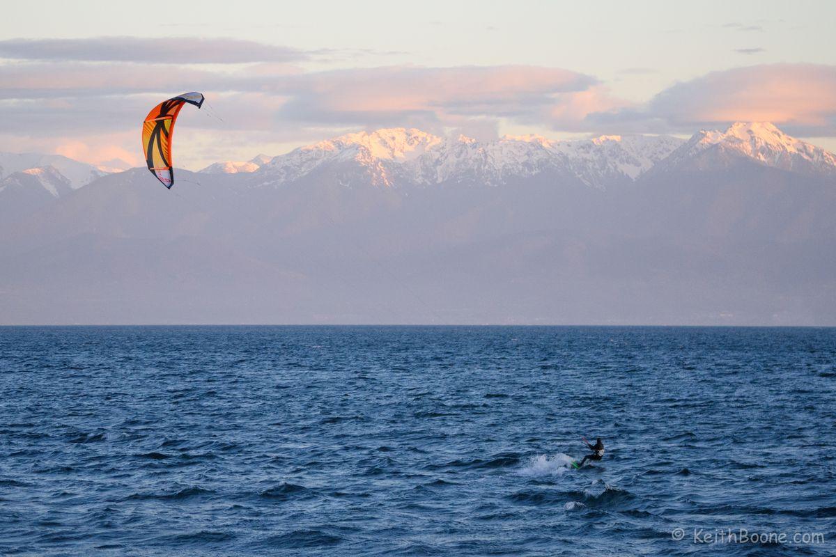 Kitesurfer against the Mountains