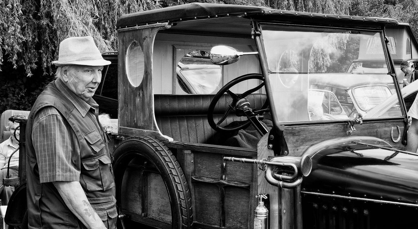 Vintage car and older man