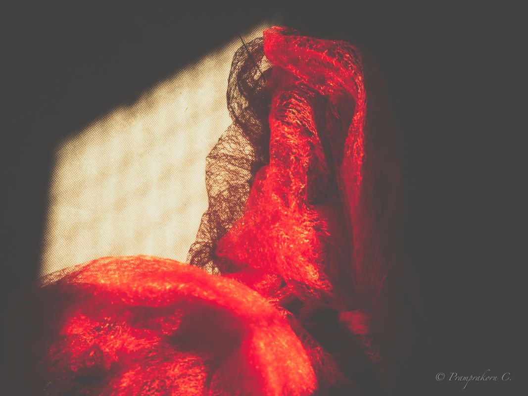 Red cloth with incoming light
